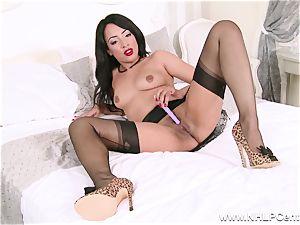 sizzling ebony stunner drains off toying in nylons girdle stilettos